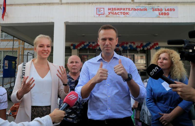 FILE PHOTO: Russian opposition leader Navalny visits a polling station during a local election in Moscow