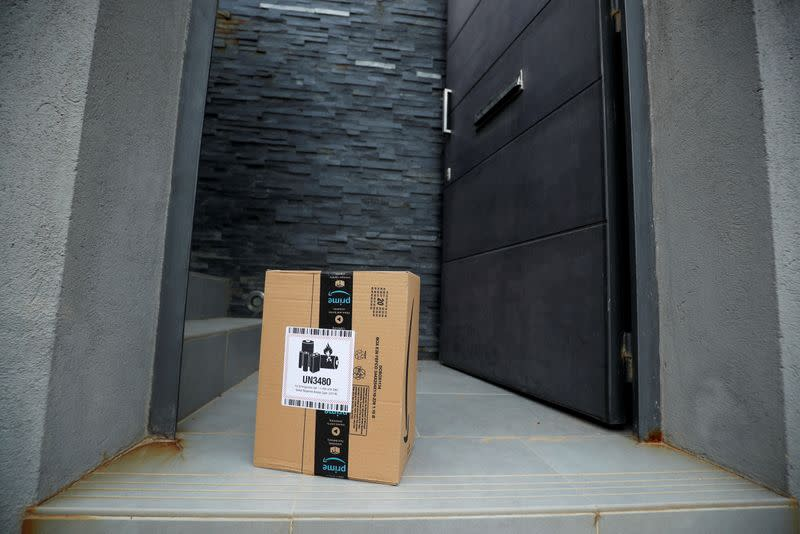 FILE PHOTO: An Amazon package is delivered and left at the door during the coronavirus disease (COVID-19) outbreak in El Masnou