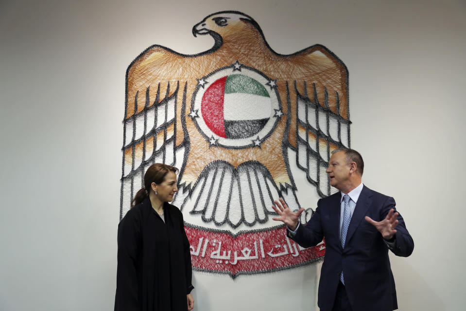 UAE Minister of State for Food and Water Security Mariam al-Muhairi, left, listens to Erel Margalit, founder and chairman of Jerusalem Venture Partners, at the headquarter of the Government Accelerators in Dubai, United Arab Emirates, Tuesday, Oct. 27, 2020. Another plane full of Israeli business people excited about their newfound access to the UAE has touched down in Dubai this week. It's the latest whirlwind trip seeking to cash in on a U.S.-brokered deal to normalize relations between the countries. (AP Photo/Kamran Jebreili)