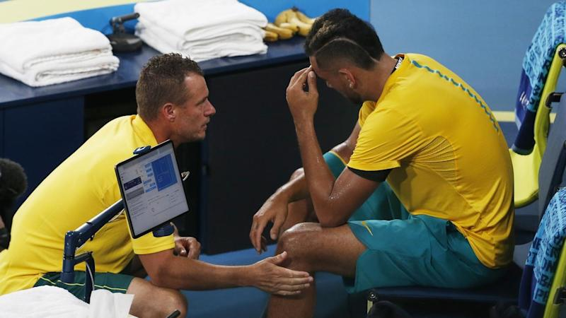 Nick Kyrgios (R) has lost the opening rubber of Australia's ATP Cup semi-final against Spain