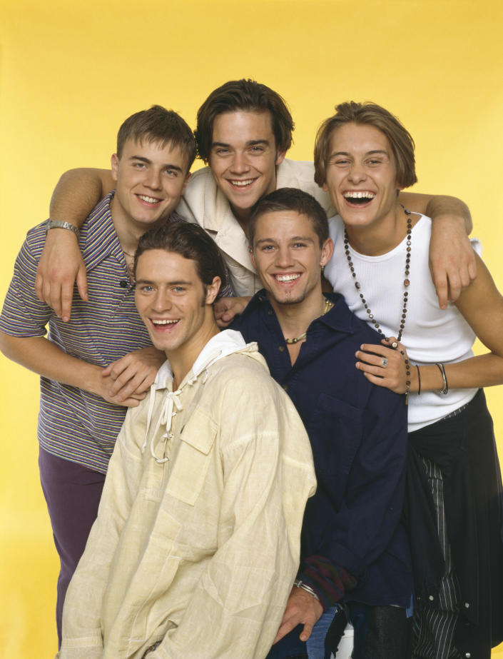 Take That, circa 1993. Clockwise, from top left: Gary Barlow, Robbie Williams, Mark Owen, Jason Orange and Howard Donald. (Photo by Tim Roney/Getty Images)