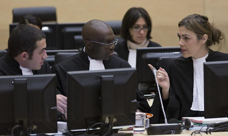 Representatives of the Office of Public Counsel for the Defence, Mohamed Youssef, left, Xavier-Jean Keita, center, and Melinda Taylor, right, are seen at the start of a hearing in the International Criminal Court (ICC) in The Hague Tuesday Oct. 9, 2012. The International Criminal Court is holding a two-day hearing into where the eldest son of former Libyan dictator Moammar Gadhafi should be put on trial. Seif al-Islam Gadhafi is charged by the international court with crimes against humanity for his alleged involvement in the deadly crackdown on dissent against his father's rule. However Libyan authorities say they want to prosecute him at home, where he is being held. (AP Photo/Michael Kooren, POOL)