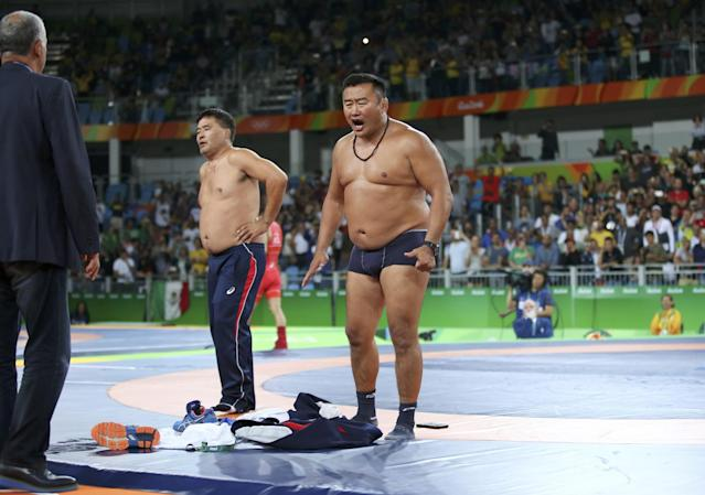 <p>Say what? Ganzorigiin Mandakhnaran of Mongolia suffered a loss in wrestling, and his coaches were pretty upset about it … so much so that they took to the mat and provided us all a strip show, shoes and all. We've seen our fair share of sore losers these Games but this might just take the cake. </p>