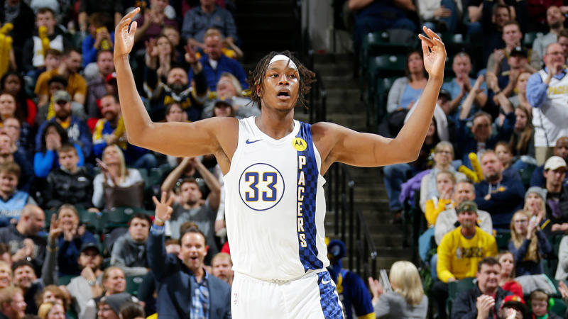 Myles Turner throwing his hands up in the air for the Indiana Pacers.