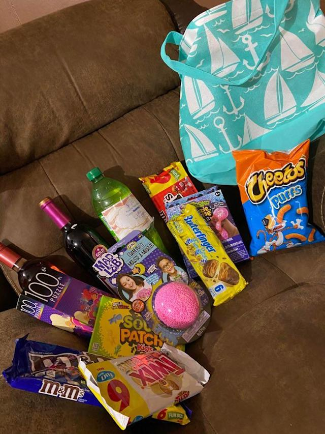 A Wine Fairies haul from Mississippi included chips, candy, wine, a puzzle and a bath bomb. (Photo: Calli Collins)