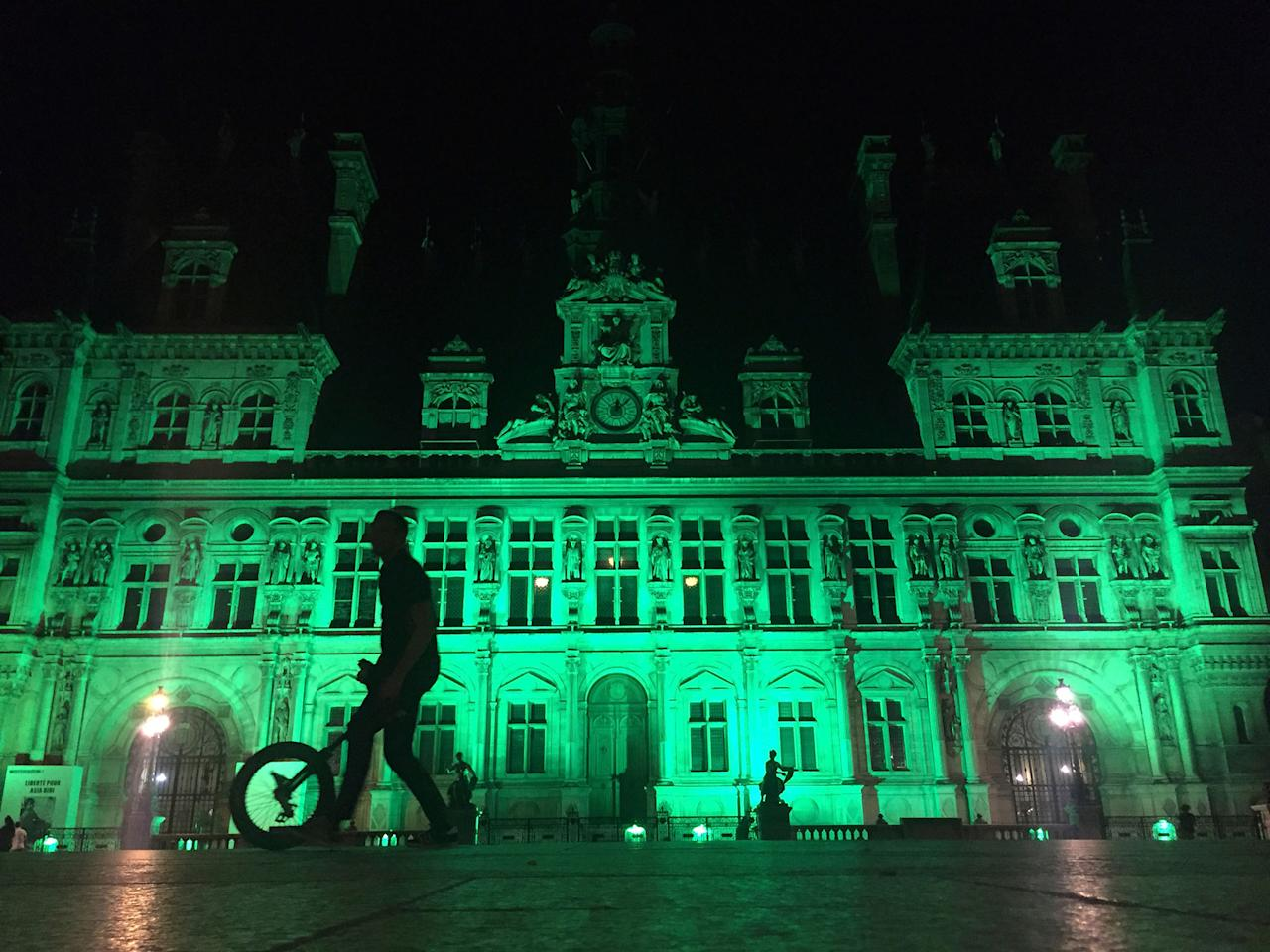 <p>The City Hall of Paris, France, was illuminated in green on June 1, 2017, following the announcement by President Donald Trump that the United States will withdraw from the 2015 Paris accord and try to negotiate a new global deal on climate change. (AP Photo/Nadine Achoui-Lesage) </p>