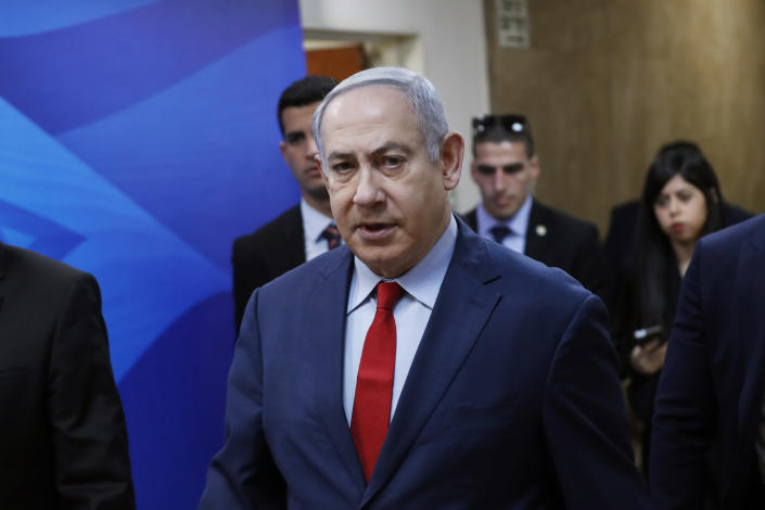 Israeli Prime Minister Benjamin Netanyahu arrives for the weekly cabinet meeting in Jerusalem, Sunday, Jan. 5, 2020. (Ronen Zvulun/Pool via AP)