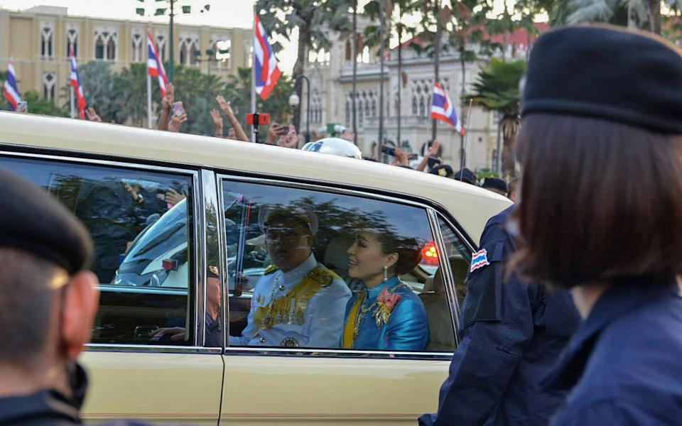 Queen Suthida and Prince Dipangkorn Rasmijoti were confronted by protesters as they drove through Bangkok - GETTY IMAGES
