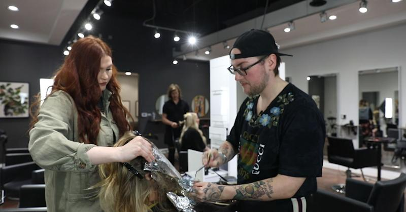 Alex Pardoe gives a client highlights at Aesthetic Hair Co. in Detroit.