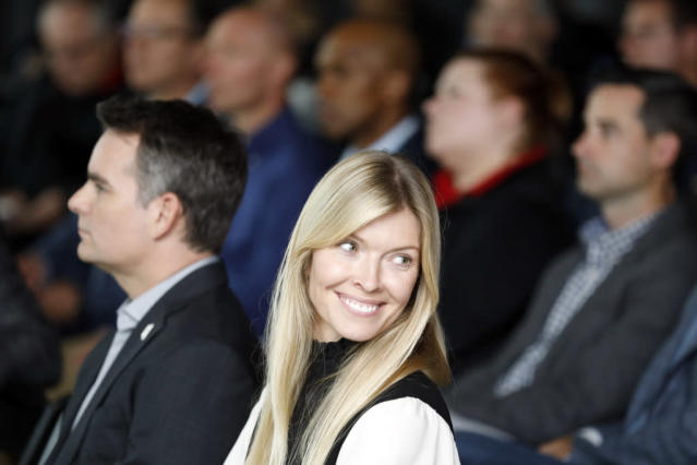 Chandra Johnson smiles during the news conference for her husband, Jimmie Johnson (AP Photo/Bob Leverone).