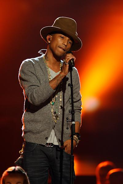 """FILE - This Jan. 27, 2014 file photo shows Pharrell Williams performing at The Night that Changed America: A Grammy Salute to the Beatles in Los Angeles. This week Pharrell released his sophomore solo album, """"G I R L,"""" which features the Oscar-nominated hit, """"Happy."""" The song is spending its second week on top of the Billboard Hot 100 chart. (Photo by Zach Cordner/Invision/AP, File)"""
