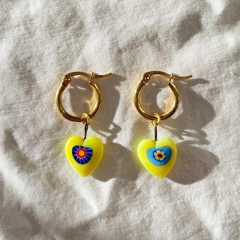 """<p><strong>Lolo</strong></p><p>lolo.nyc</p><p><strong>$8.00</strong></p><p><a href=""""https://lolo.nyc/collections/jewelry/products/vintage-yellow-millefiori-heart-earrings"""" rel=""""nofollow noopener"""" target=""""_blank"""" data-ylk=""""slk:Shop Now"""" class=""""link rapid-noclick-resp"""">Shop Now</a></p>"""