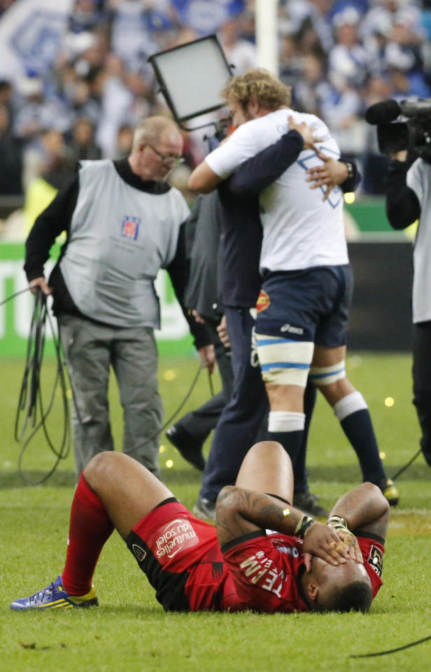 Toulon's Matthew Bastareaud , in ground, reacts after their loss to Castres Olympic at Top 14 final rugby match at Stade de France stadium in Saint Denis, north of Paris, France, Saturday, June 1, 2013. (AP Photo/Jacques Brinon)