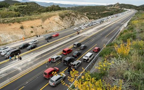 Cars come to a halt on the road - Credit: David Ramos/Getty Images