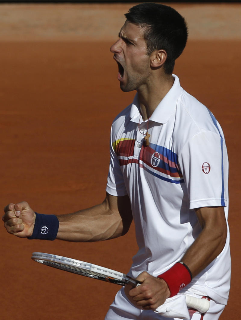 Serbia's Novak Djokovic celebrates his win over France's Richard Gasquet during their fourth round match of the French Open tennis tournament, at  the Roland Garros stadium in Paris, Sunday, May 29, 2011. (AP Photo/Michel Spingler)