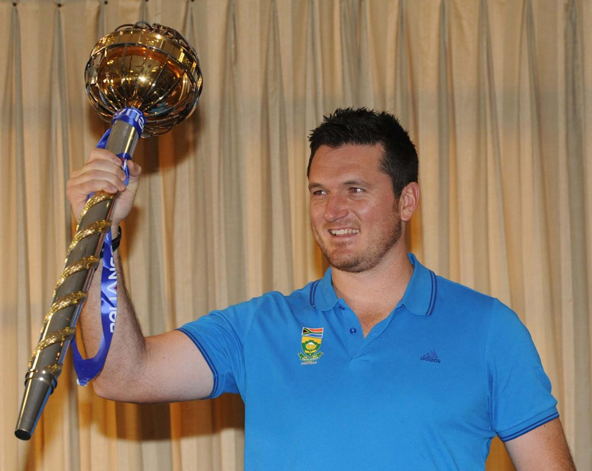 JOHANNESBURG, SOUTH AFRICA - MARCH 28: Graeme Smith of South Africa poses with the Mace during the ICC Test Championship mace handover, at Bidvest Wanderers Stadium on March 28, 2013 in Johannesburg, South Africa. (Photo by Lee Warren/Gallo Images/Getty Images)