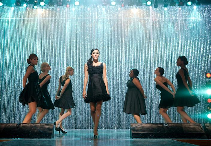 """Santana (Naya Rivera), center, performs a mashup of Adele's """"Rumour Has It"""" and """"Someone Like You"""" on """"Glee."""" <span class=""""copyright"""">(Fox Image Collection via Getty Images)</span>"""