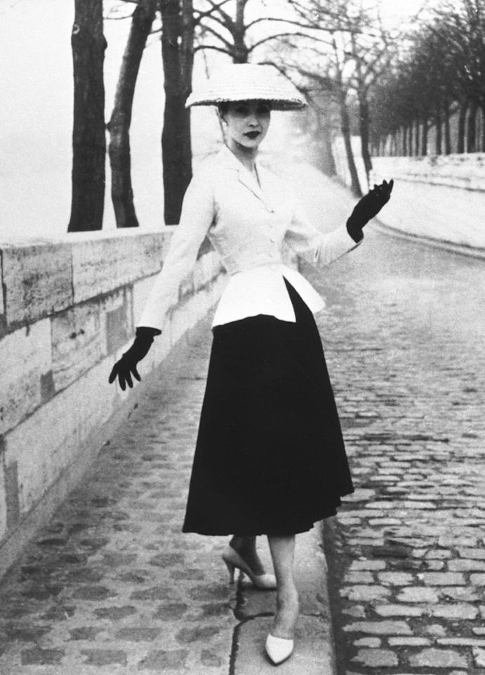 """<p>Dior was credited for reviving Haute Couture in Paris, then a dwindling fashion capital in the aftermath of World War II. In a sharp contrast to the austere ensembles in the postwar period, Dior created dresses, dubbed """"The New Look"""" with a small, nipped-in waist and a full skirt falling below mid-calf length, emphasizing an hourglass shape. As epitomized by the """"Bar"""" suit from his debut collection in 1947, Dior successfully changed the landscape of French fashion, leading other designers to emulate this look. </p>"""