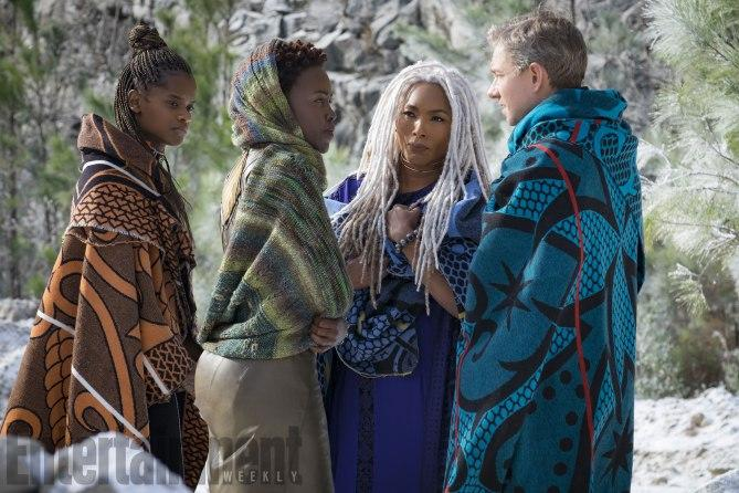 L to R: Shuri (Letitia Wright), Nakia (Lupita Nyong'o), Ramonda (Angela Bassett) and Everett K. Ross (Martin Freeman) (Credit: Entertainment Weekly, Matt Kennedy/©Marvel Studios 2018)