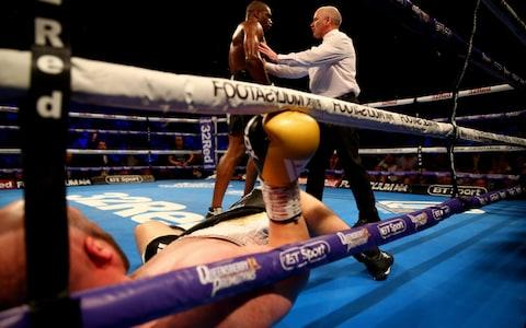 The referee tells Daniel Dubois to go to the corner after he knocks down Nathan Gorman  - Credit: getty images