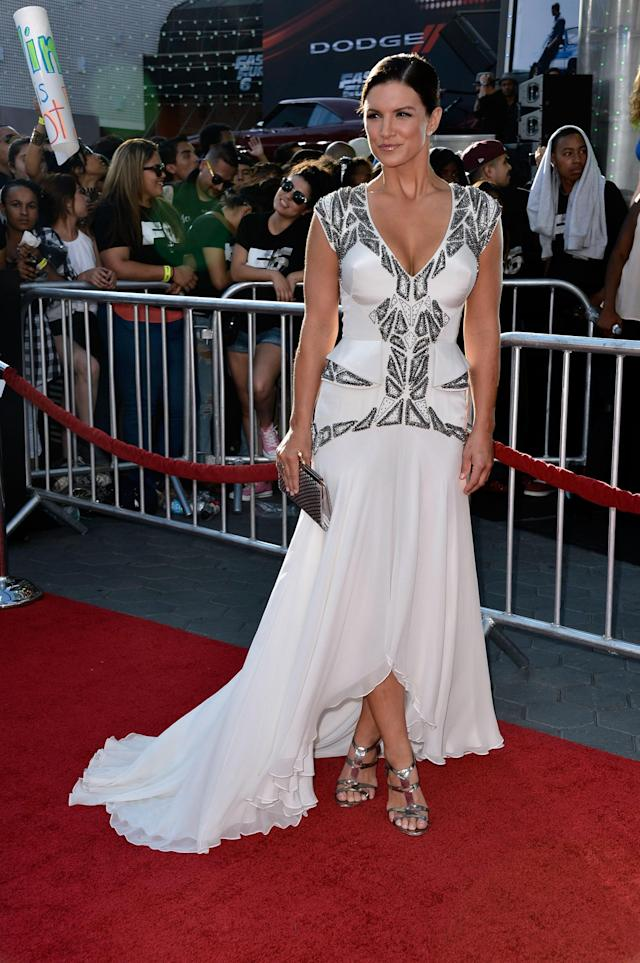 """UNIVERSAL CITY, CA - MAY 21: Actreess Gina Carano arrives at the Premiere Of Universal Pictures' """"Fast & Furious 6"""" on May 21, 2013 in Universal City, California. (Photo by Frazer Harrison/Getty Images)"""