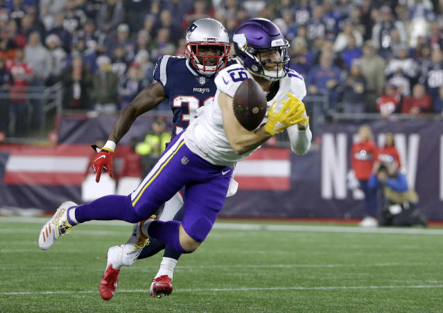 Minnesota Vikings wide receiver Adam Thielen (19) can't catch a pass in front of New England Patriots defensive back Devin McCourty during the second half of an NFL football game, Sunday, Dec. 2, 2018, in Foxborough, Mass. (AP Photo/Steven Senne)