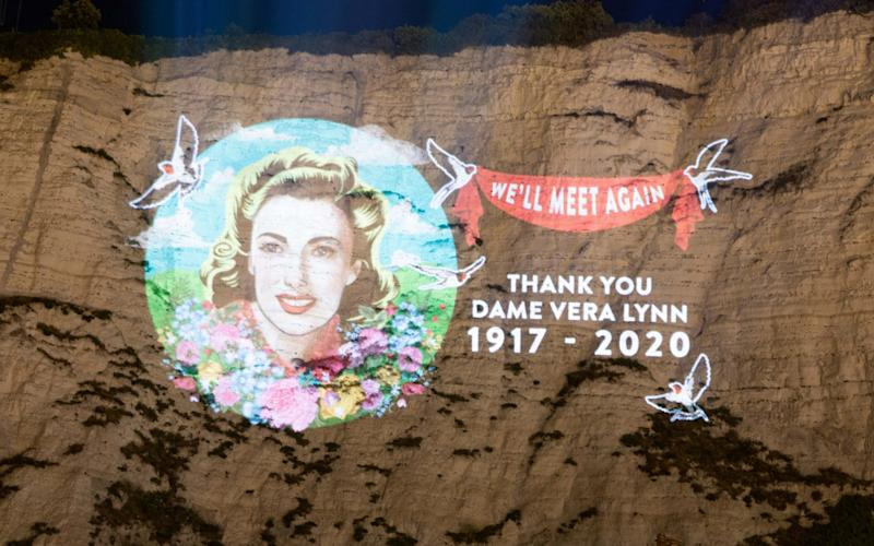 The image of Dame Vera projected onto the cliffs - Steve Turvey