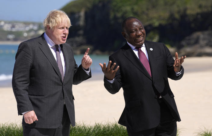 British Prime Minister Boris Johnson, left greets South African President Cyril Ramaphosa during arrivals for the G7 meeting at the Carbis Bay Hotel in Carbis Bay, St. Ives, Cornwall, England, Saturday, June 12, 2021. Leaders of the G7 gather for a second day of meetings on Saturday, in which they will discuss COVID-19, climate, foreign policy and the economy. (AP Photo/Kirsty Wigglesworth, Pool)