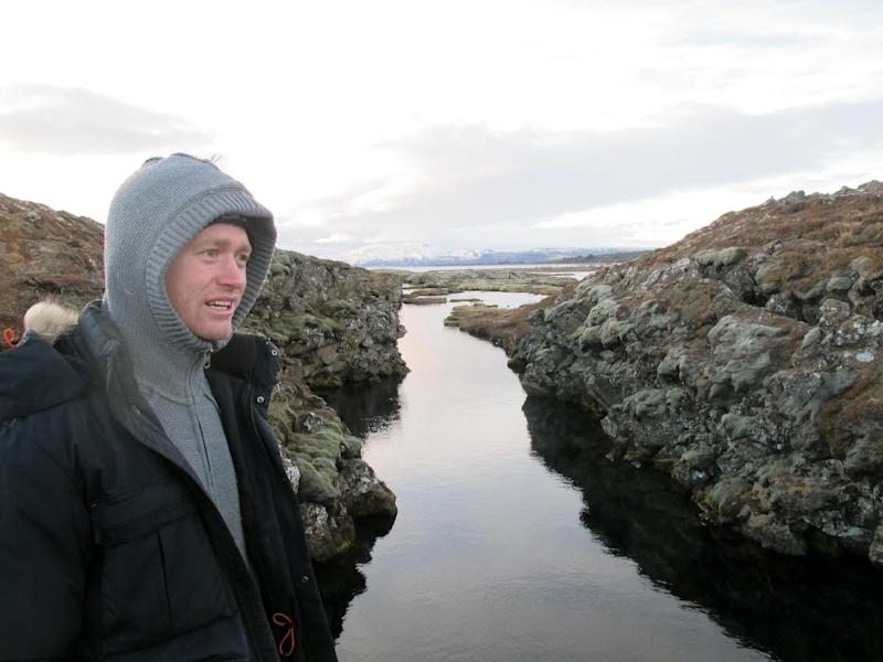 In this Jan. 23, 2013 photo, Louis Kotze of DIVE.IS gives instructions to snorkelers at Iceland's Silfra rift. Silfra, fed by glacial water, has become a popular site for diving and snorkeling despite near-freezing temperatures. (AP Photo/Jim Heintz)
