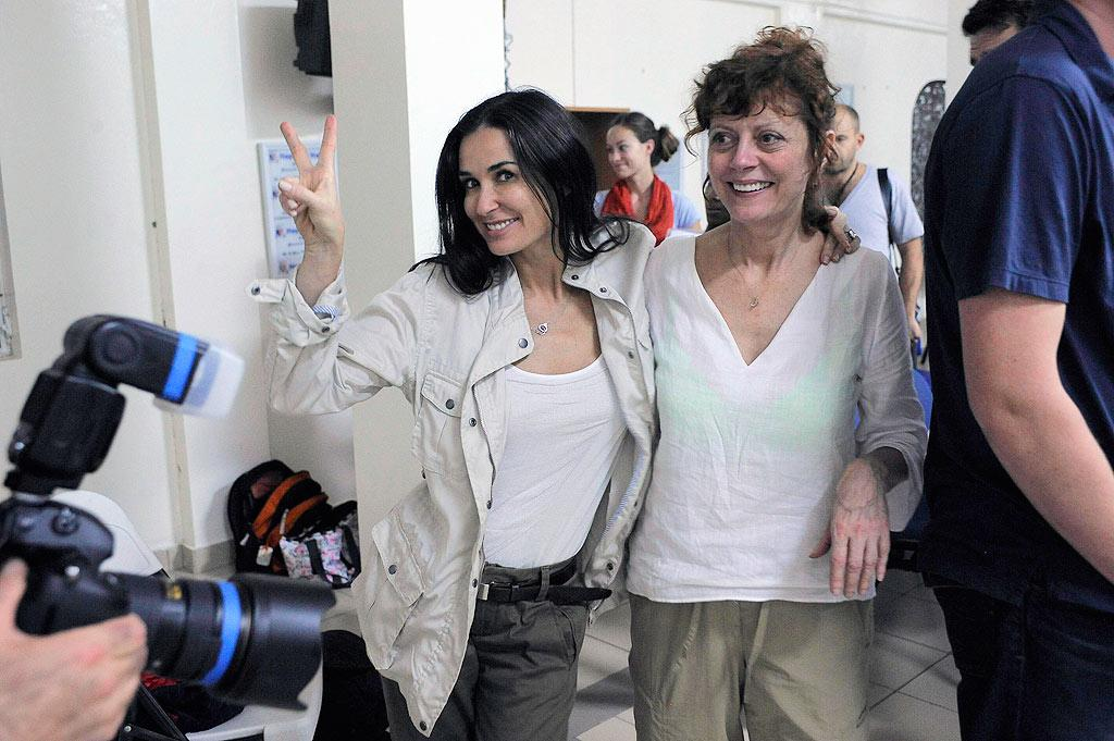 "Demi Moore and Susan Sarandon were in Haiti over the weekend as representatives for the Artists for Peace and Justice organization, which addresses issues of poverty and social justice in communities around the world. Sarandon told <i>People</i> her trip was ""overwhelming, really, and very moving."" <a href=""http://www.infdaily.com"" target=""new"">INFDaily.com</a> - April 11, 2010"