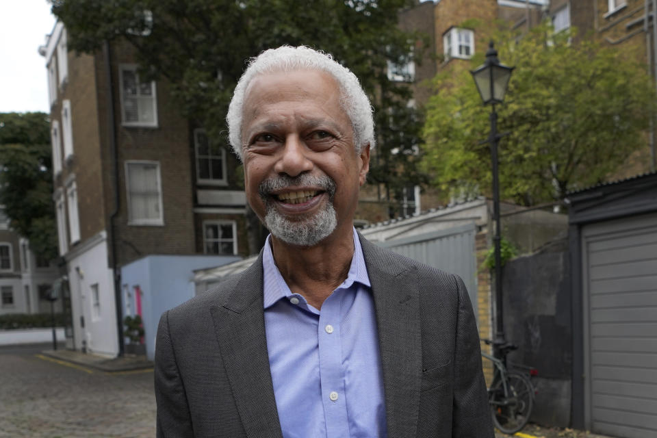 """Tanzanian writer Abdulrazak Gurnah smiles ahead of a press conference in London, Friday, Oct. 8, 2021. Gurnah was awarded the Nobel Prize for Literature on Thursday. The Swedish Academy said the award was in recognition of his """"uncompromising and compassionate penetration of the effects of colonialism."""" (AP Photo/Kirsty Wigglesworth)"""