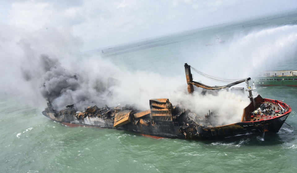 This photo provided by Sri Lankan Air Force shows the sinking MV X-Press Pearl at Kapungoda where it is anchored off Colombo port, Sri Lanka, Wednesday, June 2, 2021. Salvage experts were attempting to tow the fire-stricken container ship that had been loaded with chemicals into the deep sea as the vessel started to sink Wednesday. Water submerged the MV X-Press Pearl's quarterdeck a day after firefighters extinguished a blaze that had been burning for 12 days. (Sri Lanka Air Force via AP)