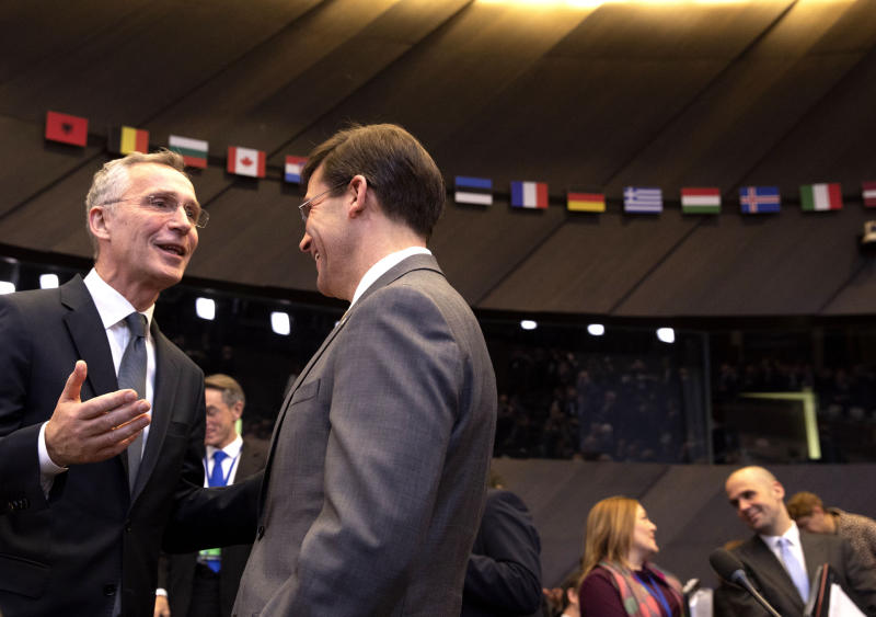 U.S. Secretary for Defense Mark Esper, second left, speaks with NATO Secretary General Jens Stoltenberg, left, during a meeting of the North Atlantic Council at NATO headquarters in Brussels, Thursday, Feb. 13, 2020. NATO ministers, in a second day of meetings, will discuss building stability in the Middle East, the Alliance's support for Afghanistan and challenges posed by Russia's missile systems. (AP Photo/Virginia Mayo)