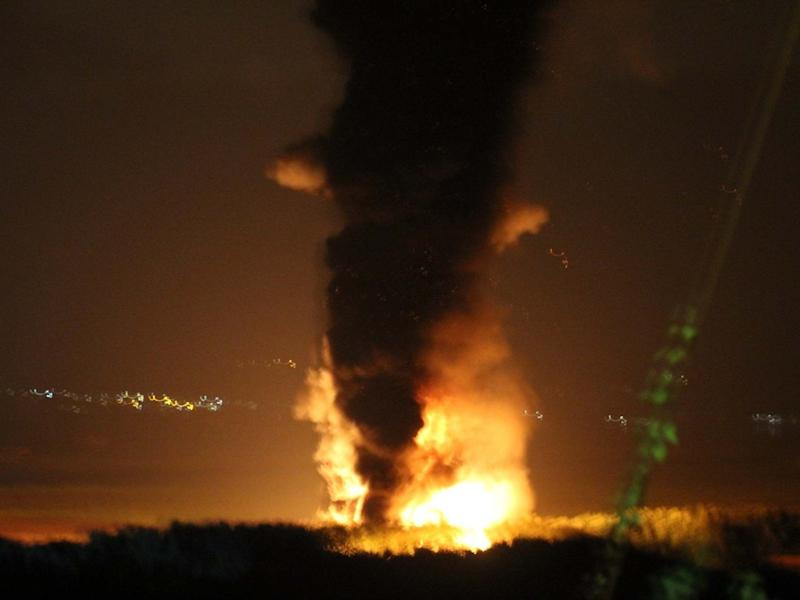 Towering flames and smoke from a large diesel train after it caught fire in Llangennech, near Llanelli, in South Wales: PA
