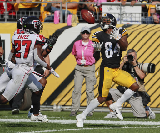 Antonio Brown reeled in two TDs in his biggest game of the season on Sunday. (AP Photo/Gene J. Puskar)