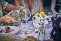 """<p>Skip the soda and just make sure your water glass is constantly getting refilled. Research shows that <a href=""""https://www.washingtonpost.com/lifestyle/wellness/disregard-that-persistent-myth-you-can-drink-water-while-eating/2019/04/19/7f8f9b44-5ca6-11e9-a00e-050dc7b82693_story.html"""" rel=""""nofollow noopener"""" target=""""_blank"""" data-ylk=""""slk:drinking water during your meal"""" class=""""link rapid-noclick-resp"""">drinking water during your meal</a> will make you feel full (so you'll eat less) and will aid in digestion. Sip on your water constantly and take breaks between bites to drink. </p>"""