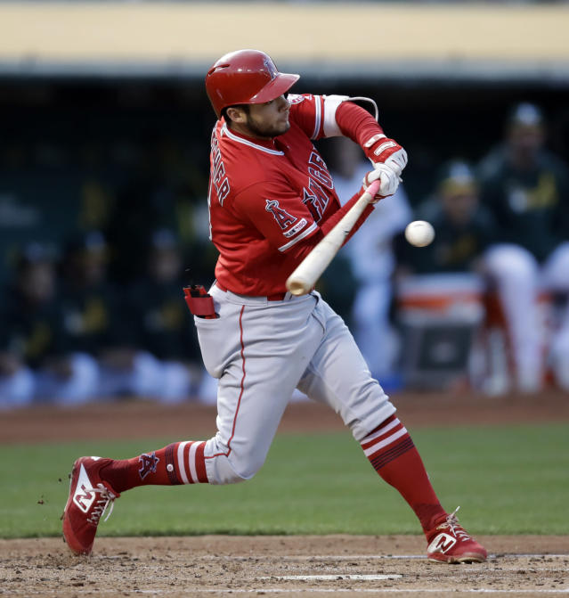 Los Angeles Angels' David Fletcher swings for a two run single off Oakland Athletics' Frankie Montas in the second inning of a baseball game Tuesday, May 28, 2019, in Oakland, Calif. (AP Photo/Ben Margot)