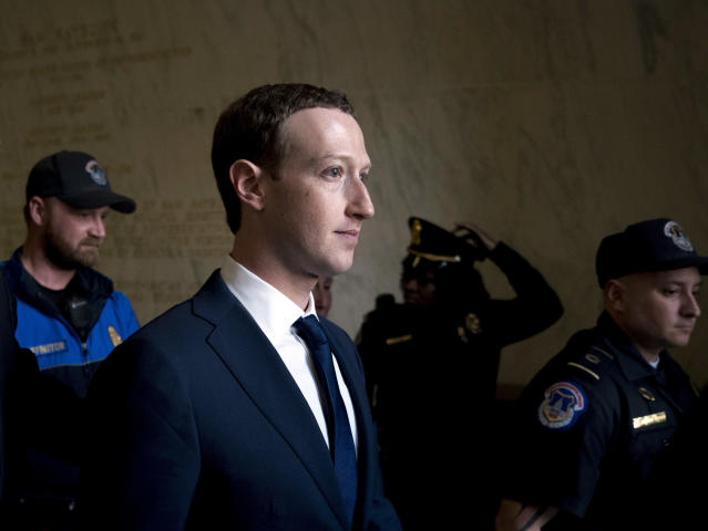 In this April 11, 2018, photo, Facebook CEO Mark Zuckerberg departs after testifying on Capitol Hill in Washington about the use of Facebook data to target American voters in the 2016 election and data privacy. (AP Photo/Andrew Harnik)