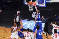Seton Hall forward Sandro Mamukelashvili (23) dunks during the second half of an NCAA college basketball game against St. John's in the quarterfinals of the Big East conference tournament, Thursday, March 11, 2021, in New York. (AP Photo/Mary Altaffer)