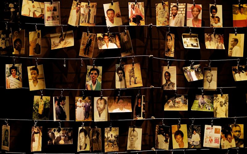 Family photographs of some of those who died hang on display in an exhibition at the Kigali Genocide Memorial centre in Rwanda - AP