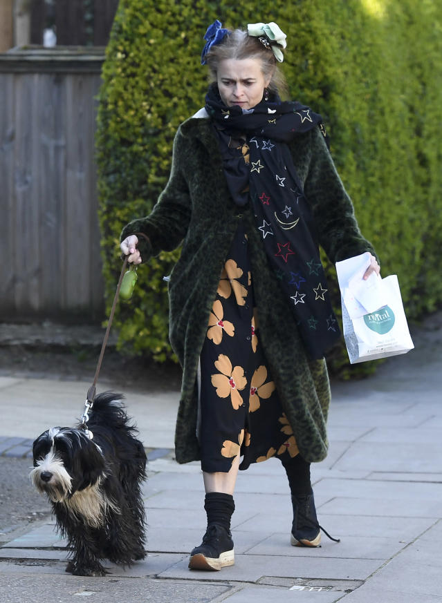 <p>Also hanging with a furry friend on Monday, Helena Bonham Carter, who walks her dog in London.</p>