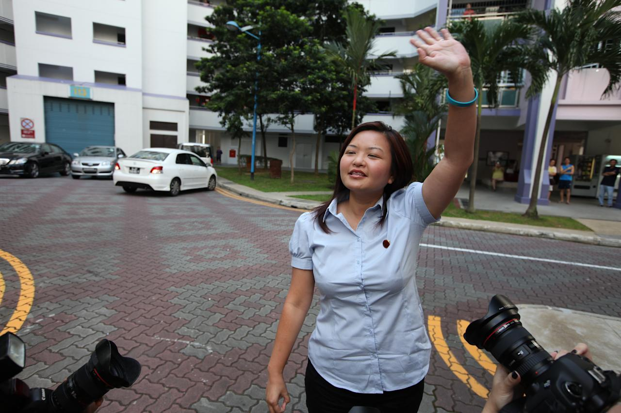 WP's Lee Li Lian greeting Punggol East residents at the than you parade.