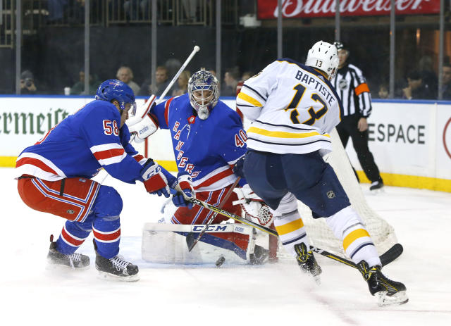 New York Rangers defenseman John Gilmour (58) and New York Rangers goaltender Alexandar Georgiev (40) defend against a shot by Buffalo Sabres right wing Nicholas Baptiste (13) during first period of an NHL hockey game, Saturday, March 24, 2018, in New York. (AP Photo/Noah K. Murray)