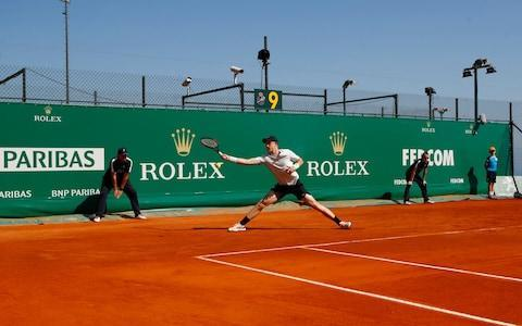 Kyle Edmund's season has an all-or-nothing feel to it so far. After the excitement of his first ATP final on Sunday, the British No 1 found himself banished to the crummiest court in Monte Carlo on Tuesday, and had soon gone down to a three-set defeat at the hands of Italy's Andreas Seppi. The result might not come as a surprise to those who know Edmund. He arrived here late on Sunday night – having crossed the continents in uncharacteristically showy style in the cabin of a private jet – and then only had time for a light practice session on Monday. A methodical man, Edmund dislikes doing things on the hoof. He never seemed to fully settle on a surface where the bounce was as up-and-down as his recent results. The first set was particularly disappointing, as he allowed Seppi to stride out to a 5-1 lead in a matter of minutes. And although he fought his way back into the match, he was fading badly towards the end of this 6-3, 5-7, 6-2 reverse. Now standing at a career high of No 23 in the world, Edmund might have expected a slightly better draw than Court 9. The view from the single creaky stand is still spectacular, with the millionaires' mansions and their helipads looming from the cliff above. But the run-backs were short and Edmund once seemed at risk of colliding with the courtside barrier as he chased one of Seppi's sharply angled forehands. These two players had already met this season in the fourth round of the Australian Open, a match that Edmund managed to turn around after losing the first set. He knows that Seppi is a supreme timer of the ball, using deft hands and clean technique to make up for a slight physique. This is a contrast with Edmund's own technique, which is to whirl into every forehand like a hammer thrower beginning his first revolution. The run-backs on court nine were short and Edmund once seemed at risk of colliding with the courtside barrier Credit: Getty Images In hotter and livelier conditions, Edmund might have been able to barge Sep