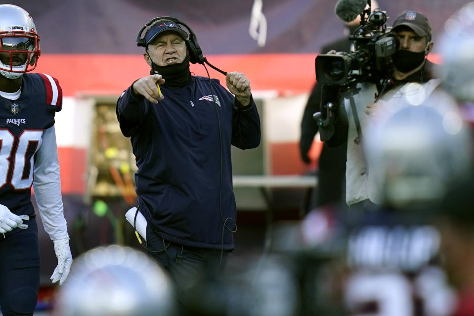 New England Patriots head coach Bill Belichick gestures from the sideline.