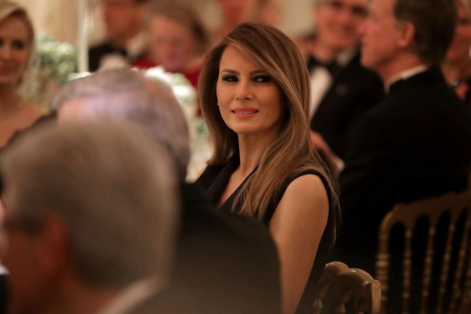 WASHINGTON, DC - FEBRUARY 26: AFP OUT U.S. first lady Melania Trump listens to a toast by her husband President Donald Trump while hosting the annual Governors' Dinner in the East Room of the White House February 26, 2017 in Washington, DC. Part of the National Governors Association�s annual meeting in the nation's capital, the black tie dinner and ball is the first formal event the Trumps will host at the White House since moving in last month. (Photo by Chip Somodevilla/Pool) *** Please Use Credit from Credit Field ***