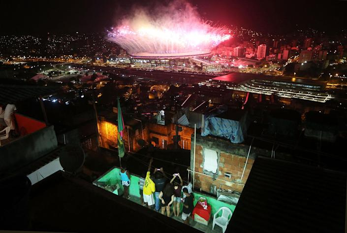 <p>AUG.5, 2016 — Fireworks explode over Maracana stadium with the Mangueira 'favela' community in the foreground during opening ceremonies for the Rio 2016 Olympic Games in Rio de Janeiro, Brazil. (Mario Tama/Getty Images) </p>