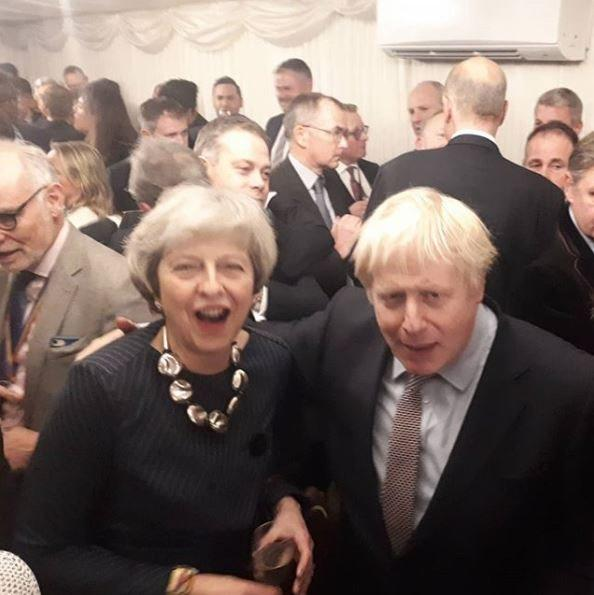 Theresa May celebrates with Boris Johnson. (PA Images)