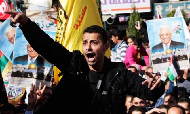 """Joyous Palestinians show their support of the U.N. resolution that would give their territory the status of """"non-member observer state"""" on Nov. 29."""