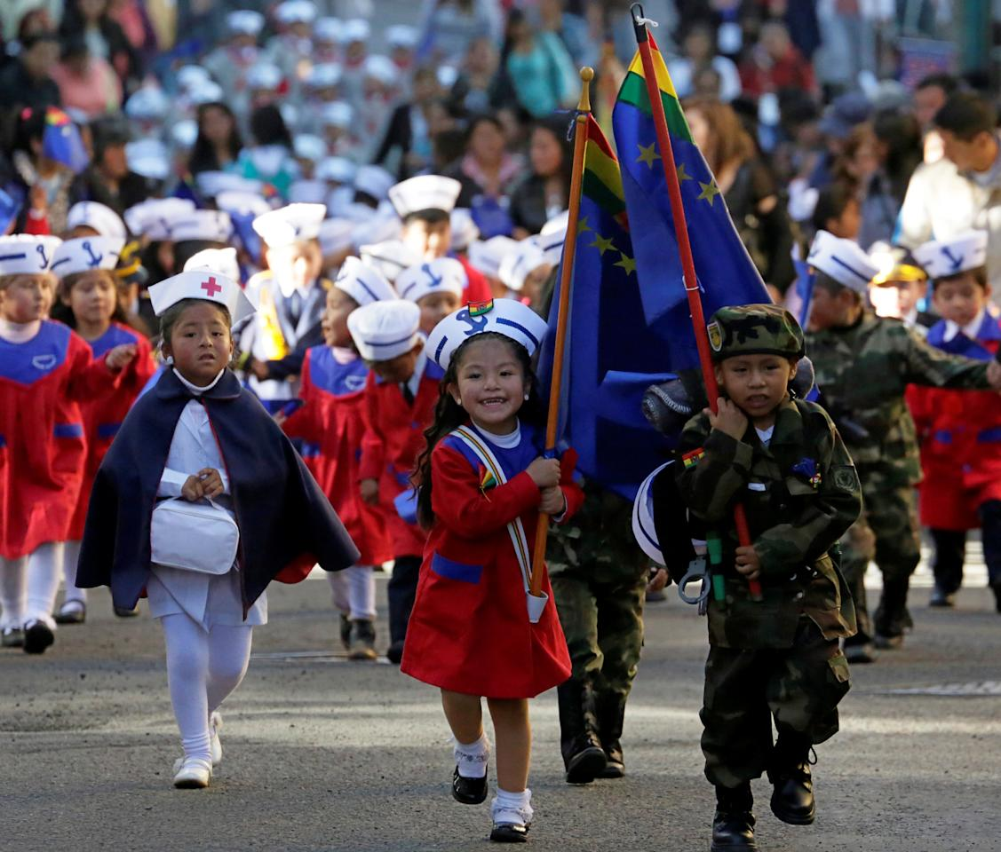 Children participate during a parade before Sea Day commemorations in La Paz, Bolivia, March 22, 2018. REUTERS/David Mercado